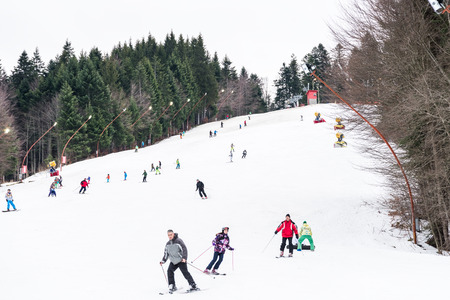 PREDEAL, ROMANIA - DECEMBER 23, 2014:  People Having Fun Skiing On Snowy Mountain Sky Resort In Predeal.