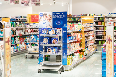 drug store: BUCHAREST, ROMANIA - DECEMBER 24, 2014: Woman Healthcare Products For Sale In Cosmetics And Healthcare Store.