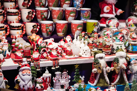 BUCHAREST, ROMANIA - DECEMBER 25, 2014: Santa Claus Souvenirs For Sale Downtown Bucharest City In The Christmas Market At Night.