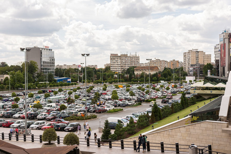 crowded space: TIMISOARA, ROMANIA - AUGUST 24, 2014: Lots Of Cars Parked In Large Public Parking Lot.