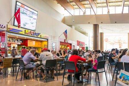 TIMISOARA, ROMANIA - AUGUST 24, 2014: People Crowd Eating Fast Food On Restaurant Floor In Luxurious Shopping Mall.