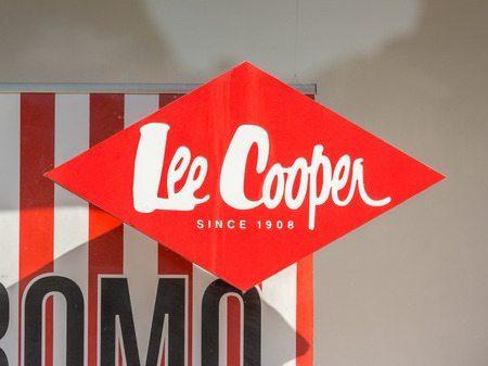 cooper: TIMISOARA, ROMANIA - AUGUST 25, 2014: Lee Cooper Store Sign Downtown in Timisoara. Lee Cooper is a British clothing company that licenses the sale of many branded items, including denim jeans.