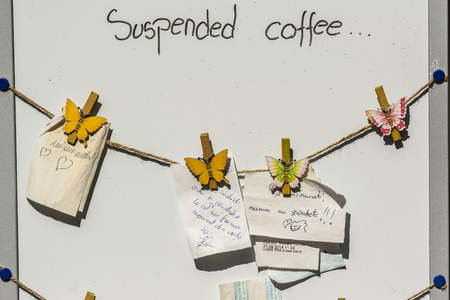 TIMISOARA, ROMANIA - AUGUST 25, 2014: Suspended Coffee Sign On Board. A suspended coffee or pending coffee is a cup of coffee paid for in advance as an anonymous act of charity. Stok Fotoğraf - 35542972