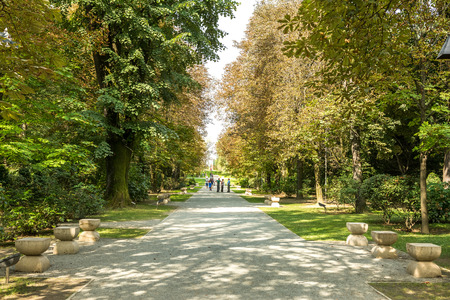 constantin: TARGU JIU, ROMANIA - AUGUST 26, 2014: The Chairs Alley located in the central park, connects The Table Of Silence with The Gate of the Kiss, historical art monuments built by Constantin Brancusi.