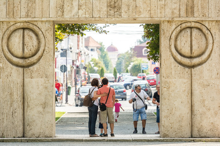 constantin: TARGU JIU, ROMANIA - AUGUST 26, 2014: The Gate of the Kiss is a stone sculpture made by Constantin Brancusi in 1938 and symbolizes the triumph of life over death. Editorial