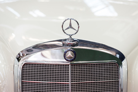 october 31: BUCHAREST, ROMANIA - OCTOBER 31, 2014: Mercedes Benz Sign Close Up. Founded in 1926 is a German luxury automobile manufacturer, a multinational division of the German manufacturer Daimler AG.