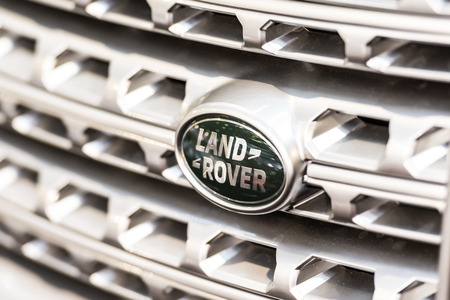 fourwheeldrive: BUCHAREST, ROMANIA - OCTOBER 31, 2014: Land Rover Sign Close Up. Founded in 1948 is a brand of the British car manufacturer Jaguar Land Rover, which specializes in four-wheel-drive vehicles.
