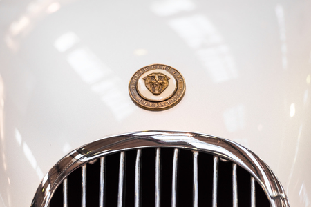 headquartered: BUCHAREST, ROMANIA - OCTOBER 31, 2014: 1952 Jaguar XK 120 Close Up. Founded in 1922 it is a British multinational luxury car manufacturer headquartered in Coventry, England.