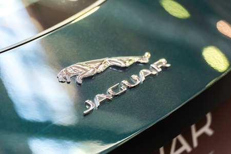 headquartered: BUCHAREST, ROMANIA - OCTOBER 31, 2014: Jaguar F Type Sign Close Up. Founded in 1922 it is a British multinational luxury car manufacturer headquartered in Coventry, England.