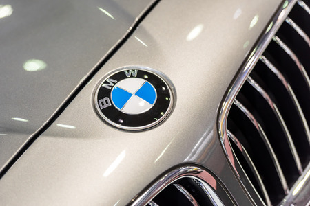 bmw: BUCHAREST, ROMANIA - OCTOBER 31, 2014: BMW Sign Close Up. Bayerische Motoren Werke AG commonly known as BMW is a German automobile, motorcycle and engine manufacturing company founded in 1916.