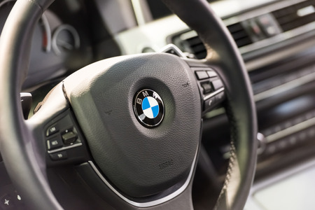 bmw: BUCHAREST, ROMANIA - OCTOBER 31, 2014: BMW Car Inside View. Bayerische Motoren Werke AG commonly known as BMW is a German automobile, motorcycle and engine manufacturing company founded in 1916.