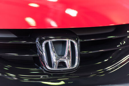 primarily: BUCHAREST, ROMANIA - OCTOBER 31, 2014: Honda Sign Close Up. Since 1959 is a Japanese public multinational corporation primarily known as a manufacturer of automobiles, motorcycles and power equipment.