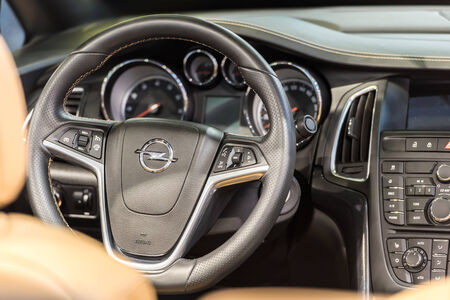 headquartered: BUCHAREST, ROMANIA - OCTOBER 31, 2014: Opel Car Inside View. Adam Opel AG is a German automobile manufacturer headquartered in Germany and began manufacturing its first automobile in 1899.