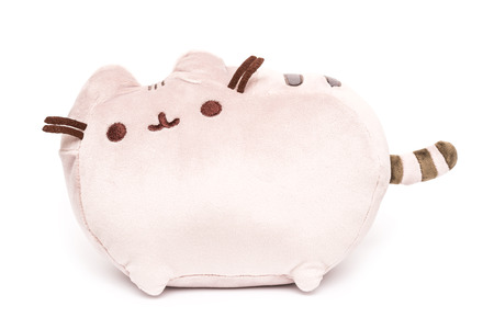 plush toy: BUCHAREST, ROMANIA - JANUARY 18, 2015: Pusheen The Cat Plush Toy Isolated. Pusheen is an animated webcomic series created in 2010 that depicts the life and dreams of the titular gray tabby cat.