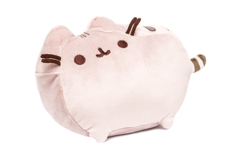 BUCHAREST, ROMANIA - JANUARY 18, 2015: Pusheen The Cat Plush Toy Isolated. Pusheen is an animated webcomic series created in 2010 that depicts the life and dreams of the titular gray tabby cat.