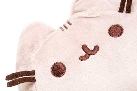 illustrative: BUCHAREST, ROMANIA - JANUARY 18, 2015: Pusheen The Cat Plush Toy Isolated. Pusheen is an animated webcomic series created in 2010 that depicts the life and dreams of the titular gray tabby cat.