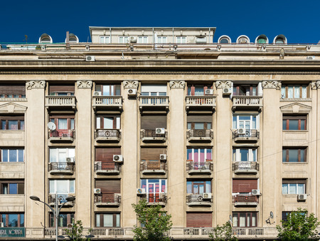 condominium complex: BUCHAREST, ROMANIA - AUGUST 30, 2014: Apartment Buildings On Magheru Boulevard one of the worlds most representative modernist boulevards, where the architecture in vogue in the 1930s is prevalent.