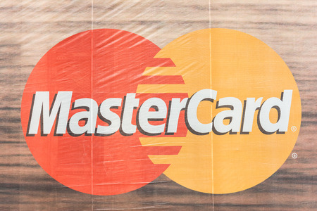 mastercard: BUCHAREST, ROMANIA - AUGUST 30, 2014: MasterCard Credit Card Advertising On Building. The main business of MasterCard is to process payments between the banks of merchants and the card issuing banks.