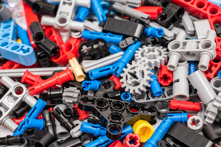 lego: BUCHAREST, ROMANIA - JANUARY 20, 2015: Lego Technic Pieces Pile Close Up. Technic is a line of Lego interconnecting plastic rods and parts that creates more advanced models with complex movable arms.