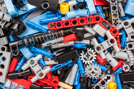 technic: BUCHAREST, ROMANIA - JANUARY 20, 2015: Lego Technic Pieces Pile Close Up. Technic is a line of Lego interconnecting plastic rods and parts that creates more advanced models with complex movable arms.