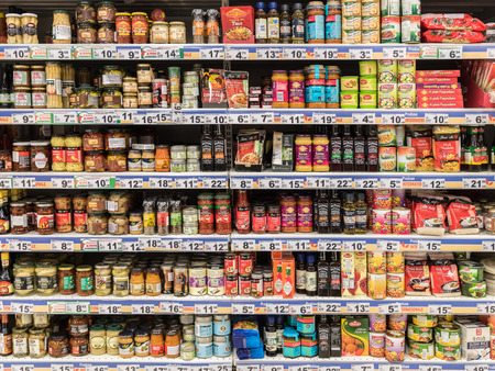 supermarkets: BUCHAREST, ROMANIA - JANUARY 20, 2015: Canned Food And Special Sauces For Sale On Supermarket Stand.
