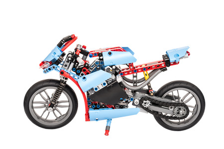 BUCHAREST, ROMANIA - JANUARY 20, 2015: Lego Technic Motorcycle Isolated. Technic is a line of Lego interconnecting plastic rods and parts that creates advanced models with more complex movable arms.