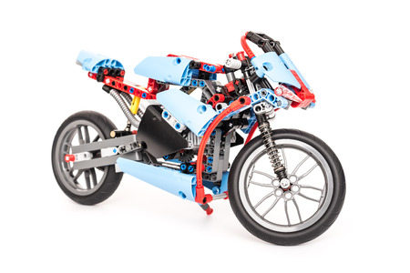 technic: BUCHAREST, ROMANIA - JANUARY 20, 2015: Lego Technic Motorcycle Isolated. Technic is a line of Lego interconnecting plastic rods and parts that creates advanced models with more complex movable arms.