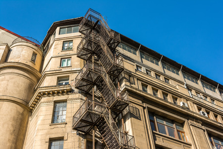Metal Fire Escape Stairs On Old Building Facade photo
