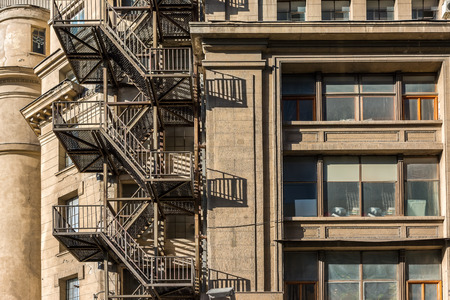 old building facade: Metal Fire Escape Stairs On Old Building Facade Stock Photo