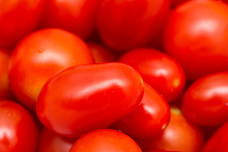 cherry tomato: Red Cherry Tomatoes Group For Sale In Vegetable Market