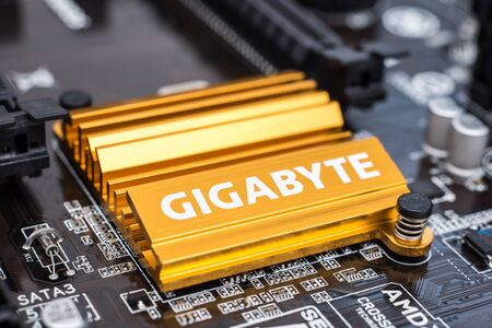 motherboard: BUCHAREST, ROMANIA - FEBRUARY 01, 2015: Gigabyte Chipset Heatsink On Motherboard. Gigabyte is an international manufacturer of computer hardware products, best known for award-winning motherboards.