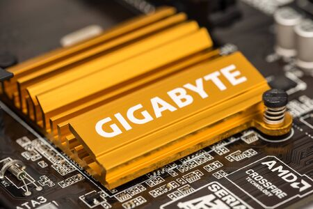 chipset: BUCHAREST, ROMANIA - FEBRUARY 02, 2015: Gigabyte Chipset Heatsink On Motherboard. Gigabyte is an international manufacturer of computer hardware products, best known for award-winning motherboards.