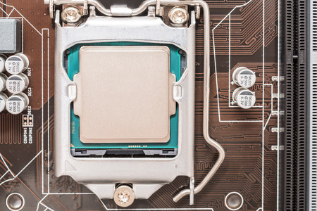 motherboard: Central Processing Unit (CPU) Chip Installed On Motherboard Socket