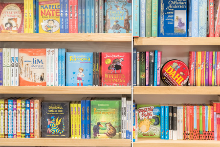 BUCHAREST, ROMANIA - FEBRUARY 12, 2015: Bookshelf In Library With Children Books For Sale.