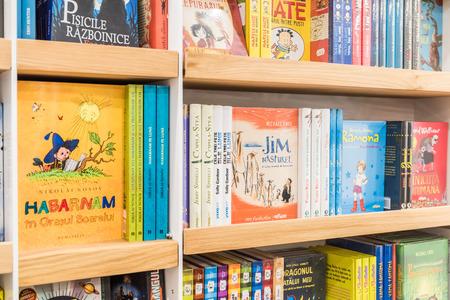 BUCHAREST, ROMANIA - FEBRUARY 12, 2015: Children Books For Sale On Bookshelf In Library.