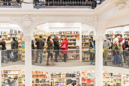 BUCHAREST, ROMANIA - FEBRUARY 12, 2015: People Shopping For Literature Books In Library.