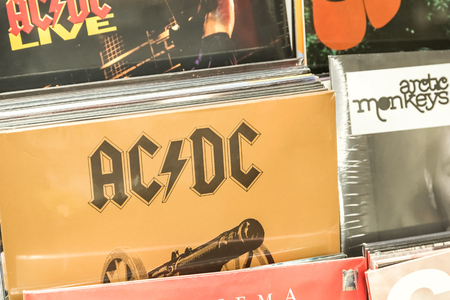 vinyl records: BUCHAREST, ROMANIA - FEBRUARY 13, 2015: Vinyl Records Featuring Famous Rock Music For Sale In Music Media Shop. Editorial