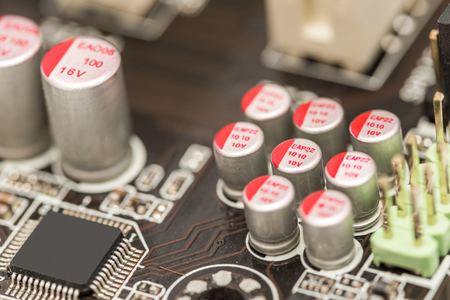 electrolytic: Computer Chip Capacitors And Resistors On Motherboard Stock Photo