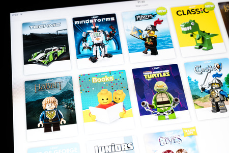 plastic bricks: BUCHAREST, ROMANIA - JANUARY 24, 2015: Lego Website On Apple iPad Air Tablet. From 1949 Lego consists of colourful interlocking plastic bricks and an array of gears and minifigures. Editorial