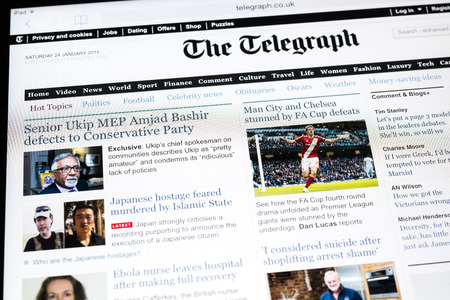 broadsheet: BUCHAREST, ROMANIA - JANUARY 24, 2015: The Telegraph Newspaper On Apple iPad Tablet. Founded in 1855 the Daily Telegraph is a daily morning UK English broadsheet newspaper published in London. Editorial