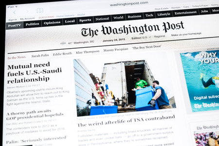 BUCHAREST, ROMANIA - JANUARY 24, 2015: The Washington Post Newspaper On Apple iPad Tablet. Founded in 1877 the Washington Post is an American daily newspaper most widely circulated in Washington D.C.