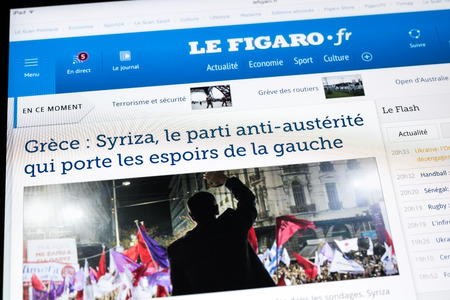 BUCHAREST, ROMANIA - JANUARY 24, 2015: Le Figaro Newspaper On Apple iPad Tablet. Le Figaro is a French daily newspaper of record founded in 1826 and published in Paris.