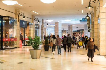 inside: BUCHAREST, ROMANIA - JANUARY 27, 2015: People Shopping In Luxury Shopping Mall Interior.