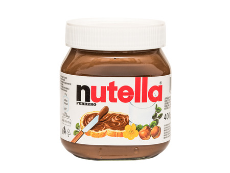 nutella: BUCHAREST, ROMANIA - FEBRUARY 25, 2015: Nutella Jar Isolated On White. From 1964 Nutella is the name of an Italian sweetened hazelnut chocolate spread manufactured by the Italian company Ferrero. Editorial