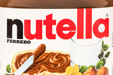 nutella: BUCHAREST, ROMANIA - FEBRUARY 25, 2015: Nutella Jar Close Up. From 1964 Nutella is the name of an Italian sweetened hazelnut chocolate spread manufactured by the Italian company Ferrero. Editorial