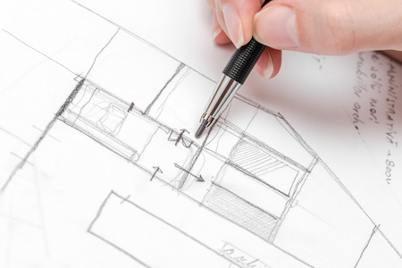 Architect Hand Drawing House Plan Sketch With Pencil Foto de archivo