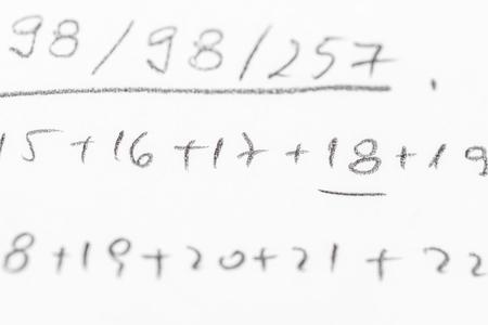 equations: School Notebook With Handwritten Algebra Equations Stock Photo