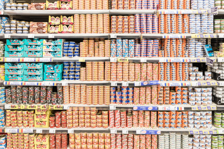 canned food: BUCHAREST, ROMANIA - JANUARY 28, 2015: Canned Food On Supermarket Stand.