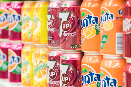 cans: BUCHAREST, ROMANIA - FEBRUARY 22, 2015: Soda Drinks On Supermarket Stand. Editorial