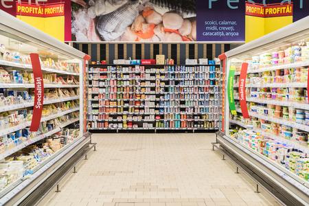 BUCHAREST, ROMANIA - FEBRUARY 25, 2015: Supermarket Food In Refrigerators On Store Aisle.